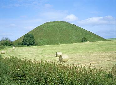 Baled hay in field below Silbury Hill, Wiltshire, England, United Kingdom, Europe