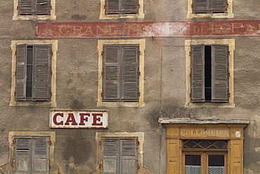 Cafe sign on the outside of an old hotel building with wooden shutters at Mauriac in the Auvergne, France, Europe