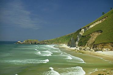 Almost deserted beach on the coast near Gijon in Asturias, Spain, Europe