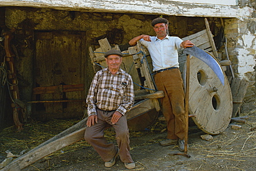 Portrait of two farmers wearing berets and looking at the camera, in Galicia, Spain, Europe
