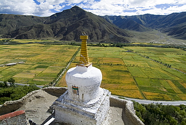 View over cultivated fields, Yumbulagung Castle, restored version of the region's oldest building, Tibet, China, Asia