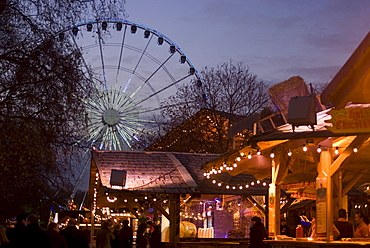 View of Ferris Wheel and food and drink stands, Winter Wonderland Christmas Fair, Hyde Park, London, England, United Kingdom, Europe