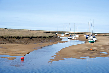 View of the harbour at low tide, morning, Wells-next-the-Sea, North Norfolk, England, United Kingdom, Europe