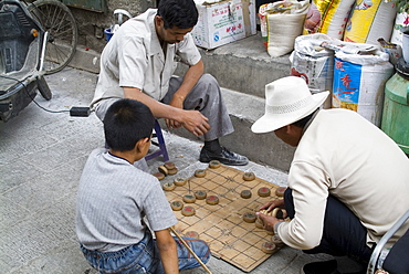 Playing a board game, Barkhor, Lhasa, Tibet, China, Asia