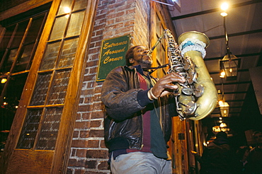 Jazz saxophonist playing at night in Bourbon Street, New Orleans, Louisiana, United States of America, North America