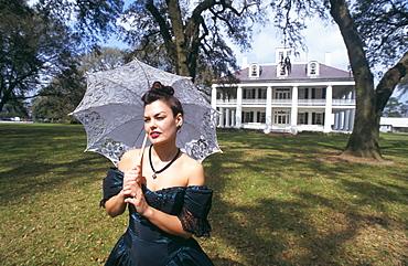 Guide in garden at Houma House, Plantation, Louisiana, United States of America, North America