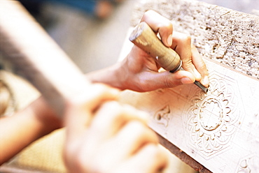 Craftsman using chisel on stone, Fez, Morocco, North Africa, Africa