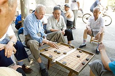 Elderly men playing a form of chess, Hu Hai Lake, Beijing, China, Asia