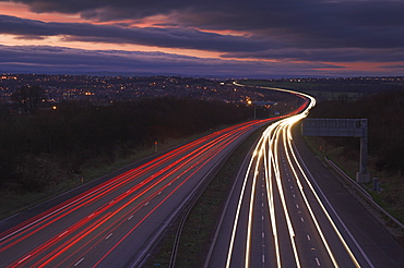 Traffic light trails in the evening on the M1 motorway near junction 28, Derbyshire, England, United Kingdom, Europe