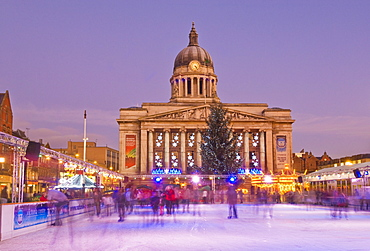 Ice skaters on the temporary Christmas outdoor ice skating rink in the Old Market Square in front of the Council House in the city centre, Nottingham, Nottinghamshire, England, United Kingdom, Europe