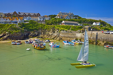 Small fishing boats and a catamaran at low tide, Newquay harbour, Newquay, Cornwall, England, United Kingdom, Europe