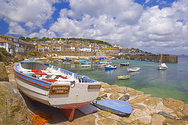 Small boat on the quay and small boats in the enclosed harbour at Mousehole, Cornwall, England, United Kingdom, Europe