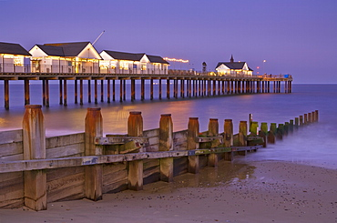 Southwold pier and wooden groyne at sunset, Southwold, Suffolk, England, United Kingdom, Europe