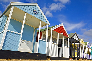 Brightly painted beach huts in the afternoon sunshine, on the seafront promenade, Southwold, Suffolk, England, United Kingdom, Europe