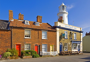 The Sole Bay Inn pub with Southwold lighthouse behind, Southwold, Suffolk, England, United Kingdom, Europe