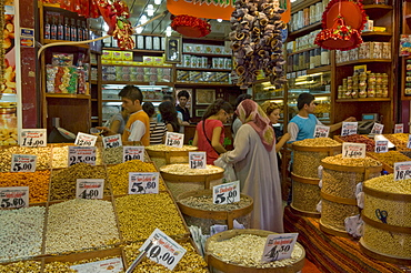 People buying pulses, nuts and spices at a stall in the Egyptian bazaar (Spice bazaar) (Misir Carsisi), Eminonu, Istanbul, Turkey, Europe