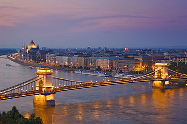 Panorama of the city at sunset with the Hungarian Parliament building, and the Chain bridge (Szechenyi Lanchid), over the River Danube, UNESCO World Heritage Site, Budapest, Hungary, Europe