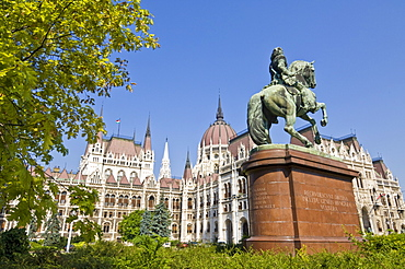 The neo-gothic Hungarian Parliament building front entrance, designed by Imre Steindl, with an equestrian statue of Ferenc Rakoczi II in foreground, Budapest, Hungary, Europe
