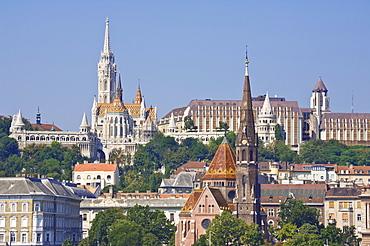 The Capuchin Church (Kapucinus templom) in the foreground, Matyas church (Matyas templom) and the Fishermen's bastion (Halaszbastya), Buda side of the Danube, Budapest, Hungary, Europe