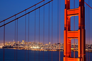 The Golden Gate Bridge, linking the city of San Francisco with Marin County, taken from the Marin Headlands at night with the city in the background, Marin County, California, United States of America, North America