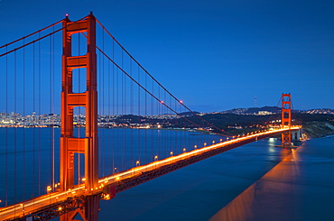 The Golden Gate Bridge, from the Marin Headlands at night with the city of San Francisco in the background and traffic light trails across the bridge, Marin County, San Francisco,  California, United States of America, North America