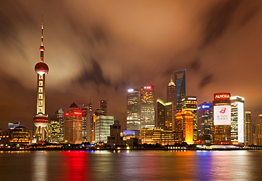 City skyline at night with Oriental Pearl Tower and Pudong skyscrapers across the Huangpu River, Shanghai, China, Asia