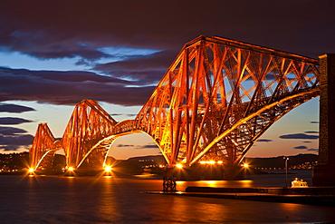 Forth Rail Bridge over the River Forth illuminated at night, South Queensferry, Edinburgh, Midlothian, Scotland, United Kingdom, Europe