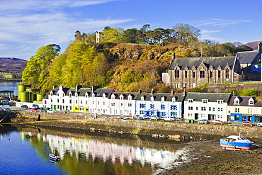 Multi-coloured houses with reflections in Portree harbour, Isle of Skye, Inner Hebrides, Highlands and Islands, Scotland, United Kingdom, Europe