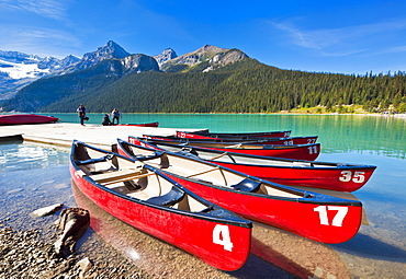 Red canoes for hire on Lake Louise, Banff National Park, UNESCO World Heritage Site, Alberta, The Rockies, Canada, North America