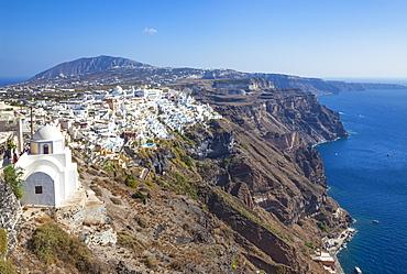 Fira town and greek Church of Saint Stylianos, Firostefani, Santorini (Thira), Cyclades Islands, Greek Islands, Greece, Europe