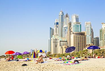 Sunbathers on the Public Dubai Beach at JBR (Jumeirah Beach Resort), Dubai, United Arab Emirates, Middle East