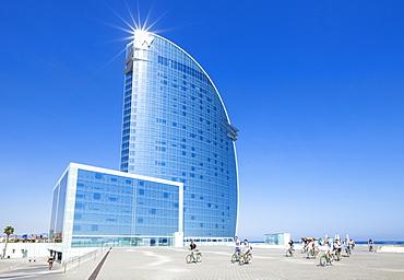 Cyclists outside the Hotel W at Barceloneta, Barcelona, Catalonia (Catalunya), Spain, Europe