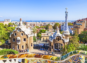 Entrance lodge to Parc Guell designed by Antoni Gaudi, UNESCO World Heritage Site, with a skyline view of the city of Barcelona, Catalonia (Catalunya), Spain, Europe
