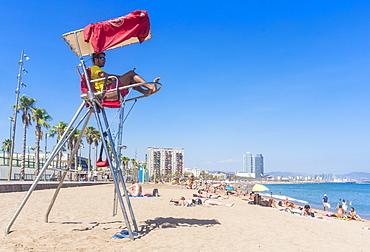 Lifeguard stationed at Barcelona beach of Barceloneta, Barcelona, Catalonia (Catalunya), Spain, Europe