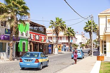 Local taxi driving down the main street, Rua 1 de Junho, Praca Central, Santa Maria, Sal island, Cape Verde, Africa