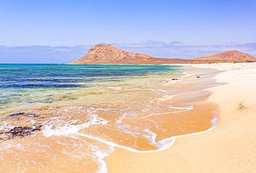 Empty sandy beach and bay near Monte Leao mountain (Sleeping Lion mountain), Sal Island, Cape Verde, Atlantic, Africa