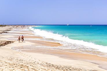 Tourists walking along the sandy beach, Ponta Preta beach, Santa Maria, Sal Island, Cape Verde, Atlantic, Africa