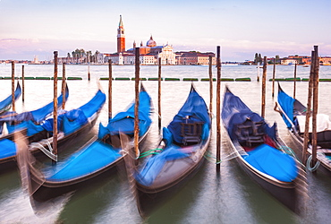 Gondolas moored at sunset in the Bacino di San Marco (St. Mark's Basin), waterfront, Venice, UNESCO World Heritage Site, Veneto, Italy, Europe
