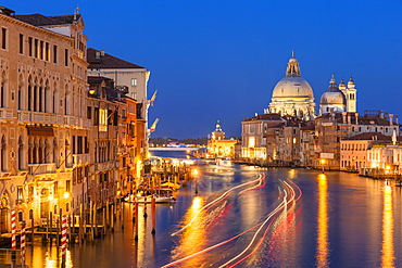 Grand Canal, and the church of Santa Maria della Salute, at night, with boat light trails, Venice, UNESCO World Heritage Site, Veneto, Italy, Europe