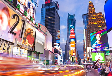 Bright billboards, busy traffic light trails, Times Square, Broadway, Theatre District, Manhattan, New York, United States of America, North America