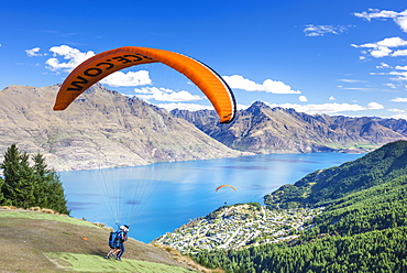 Tandem Paragliding, from Bob's Peak above Lake Wakatipu, Queenstown, Otago, South Island, New Zealand, Pacific