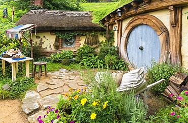 Hobbiton, wooden doors of Hobbit holes in the film set fictional village of Hobbiton, Matamata, North Island, New Zealand, Pacific