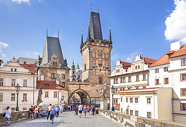 The Lesser Town Bridge Tower of Charles Bridge with people visiting the Mala Strana district, UNESCO World Heritage Site, Prague, Czech Republic, Europe