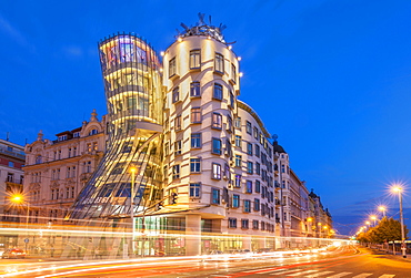 Dancing House (Ginger and Fred) at night by Frank Gehry, busy traffic light trails, Prague, Bohemia, Czech Republic, Europe
