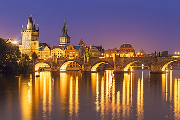 Prague Charles bridge, Old town bridge tower and river Vltava at night, UNESCO World Heritage Site, Prague, Czech Republic, Europe