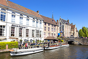 Boat tours on The Den Dijver Bruges canal in front of the Hotel De Orangerie in Bruges, Belgium, Europe