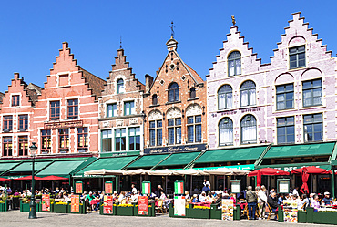 Cafes in the Market Square in the centre of Bruges, West Flanders, Belgium, Europe