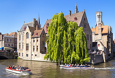 Bruges Belfry and tourist boats on Den Dijver Bruges Canal, Bruges, UNESCO World Heritage Site, West Flanders, Belgium, Europe