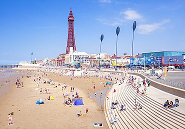 Blackpool Tower, Blackpool beach and seafront promenade with holidaymakers and tourists, Blackpool, Lancashire, England, United Kingdom, Europe