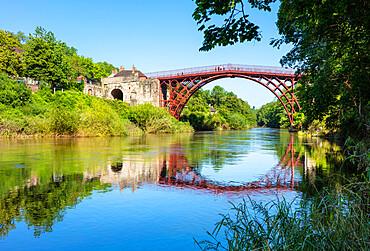 Red Ironbridge bridge over river Severn with reflection Ironbridge gorge Iron bridge Shropshire England GB UK europe